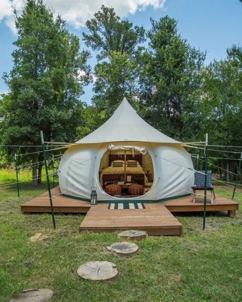 5m 16ft Lotus Belle Tent On A Raised Platform With Poles For The Guys Lines Good For Increasing Breath Lotus Belle Tent Tent Glamping Luxury Camping Tents