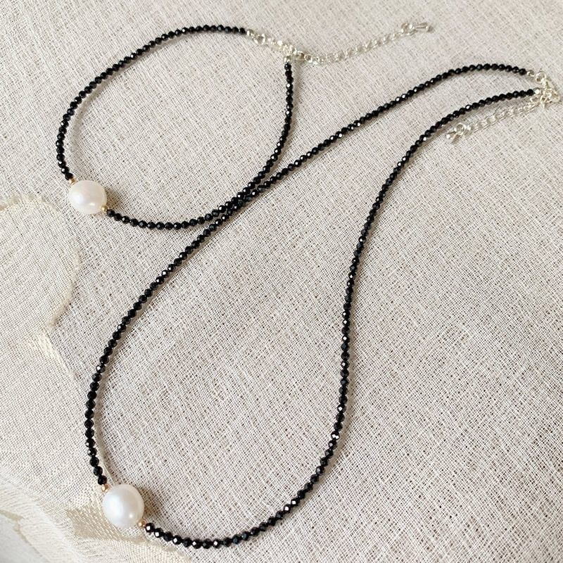 Black beaded chain necklace and baroque charm