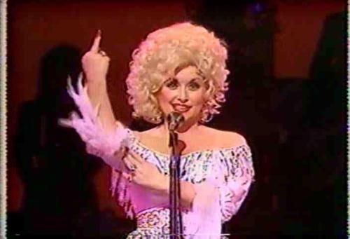 Dolly, one of my heroes, flipping the bird is PURE JOY