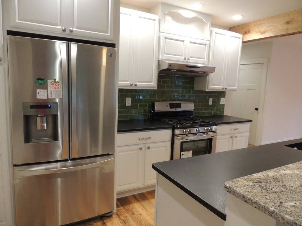 Black Pearl Leathered Granite Installation Kitchen Cabinets And Countertops Leather Granite Countertops