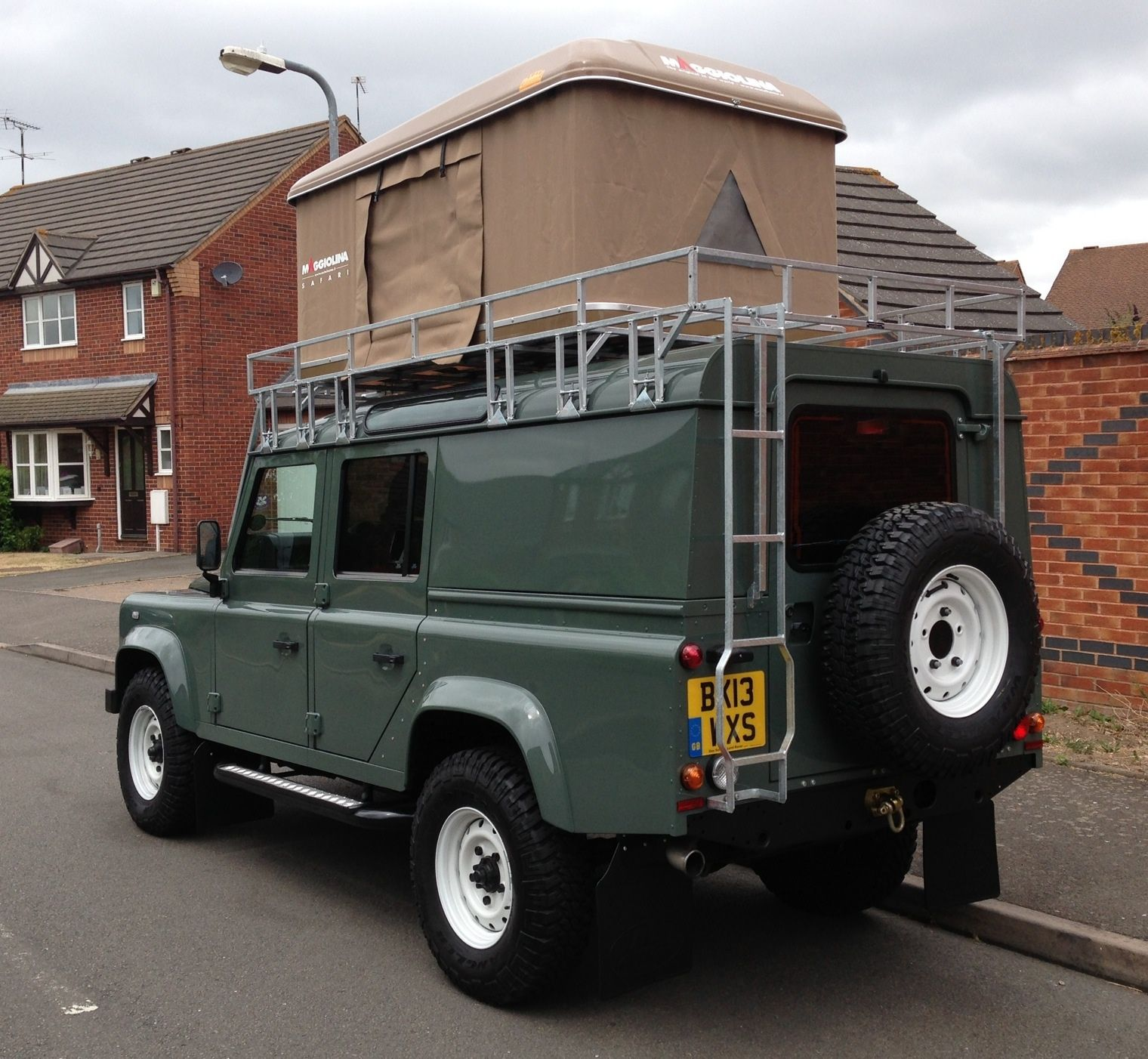 Defender 110 With Full Roof Rack And Maggiolina Roof Tent Land Rover Camping Land Rover Land Rover Defender Camping