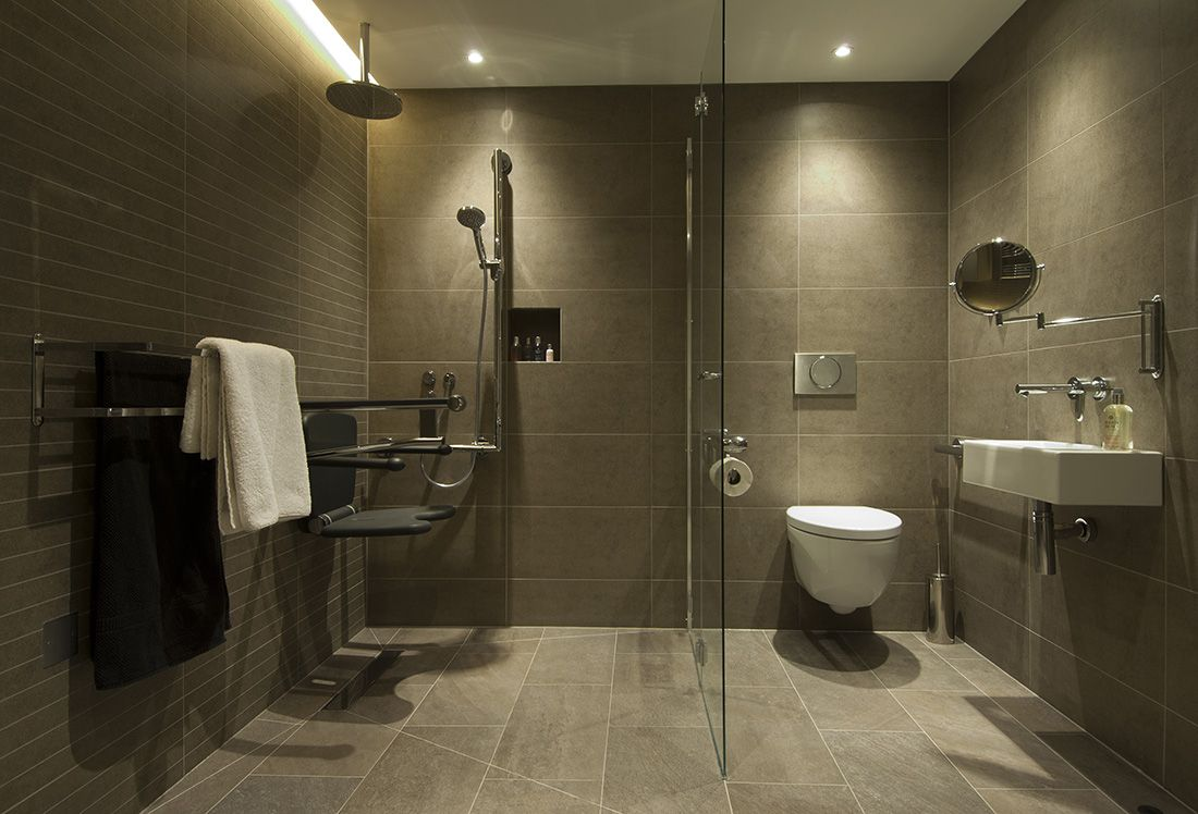 A contemporary accessible bathroom Motionspot