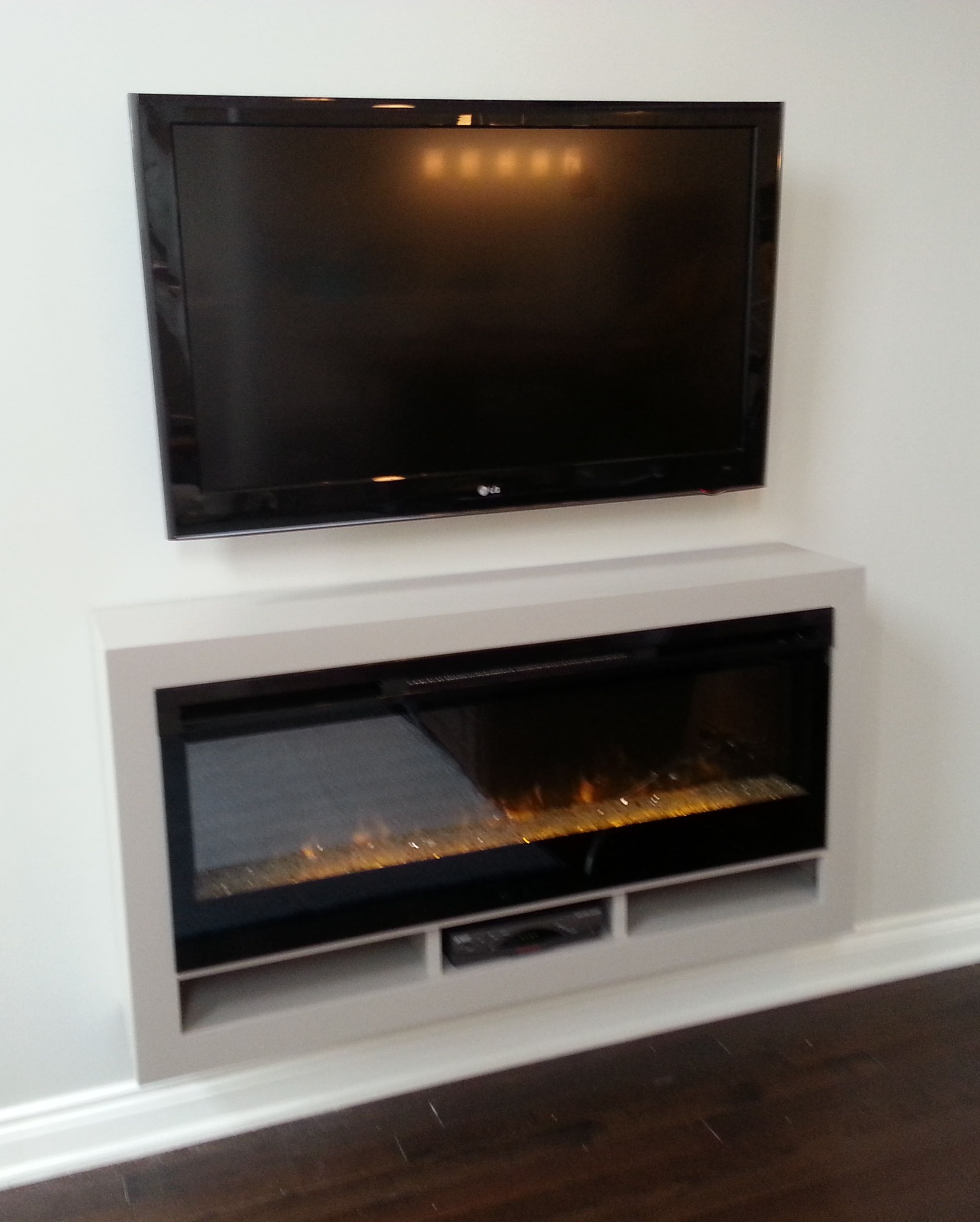 Dimplex BLF-50 electric fireplace in a custom floating cabinet.  $1249.00 CAD for fireplace only.  Cabinet design and installation by Stylish Fireplaces.