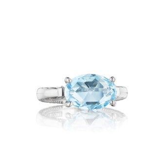 A truly unique design! The stylish oval shaped Sky Blue Topaz gemstone and the Tacori crescents bordering the sculpted silver band, makes this flirtatious cocktail ring both classic yet refreshing the same time.