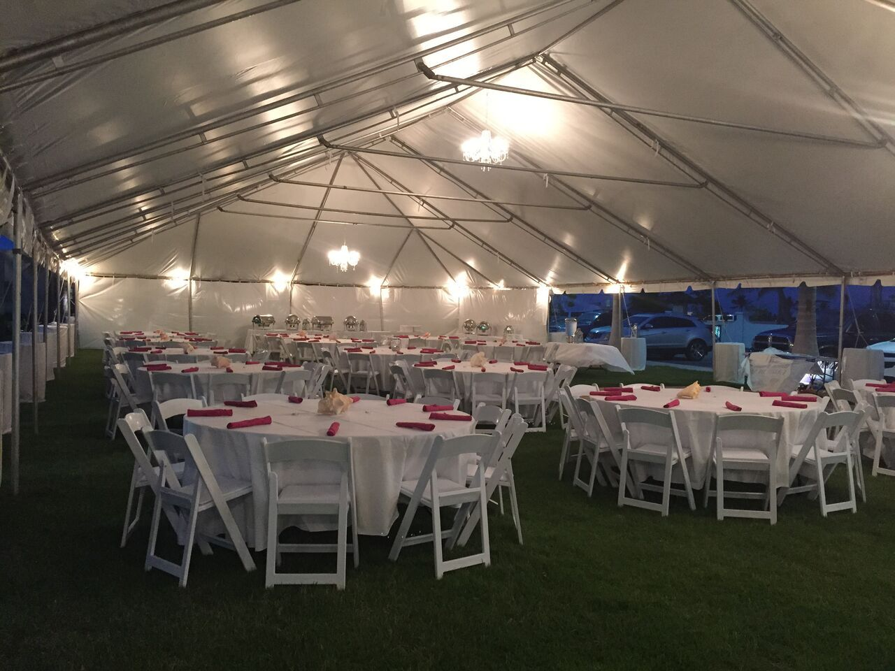 Chandelier lighting under the tent on the Parish Event