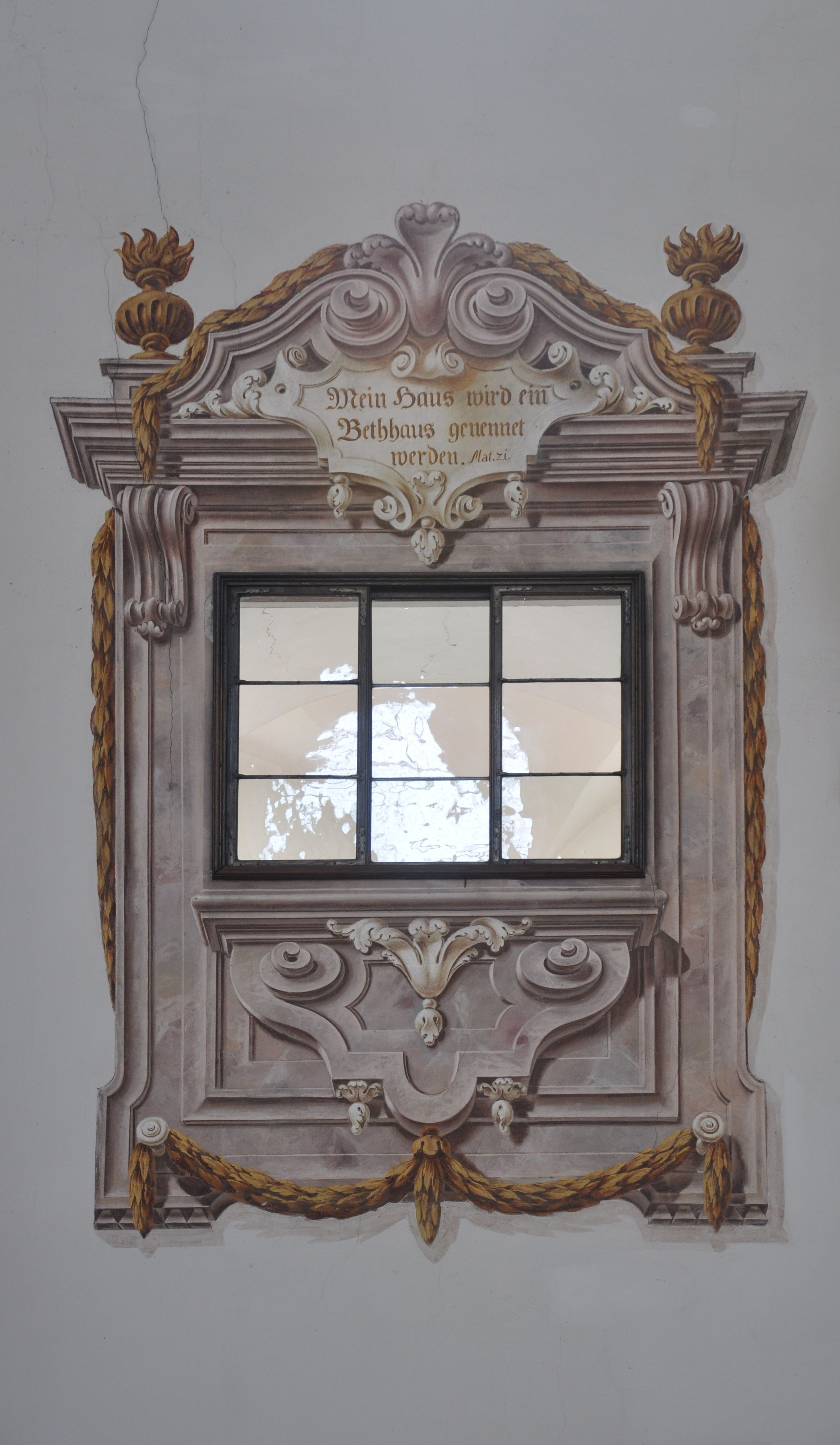 Painted Architectural Embellishment Around A Plain Window In A Plain Stucco Wall Decorative