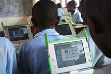 "OneLaptopPerChildatKaguguPrimarySchoolKigaliRwanda19Sept2009. Details in ""Addendum to Solar Education-One Laptop Per Child (OLPC)'s New XO 3.0 tablet"" of Sun Is The Future, Jan. 30, 2012 post of www.sunisthefuture.net (just click on the image twice to view the post)"