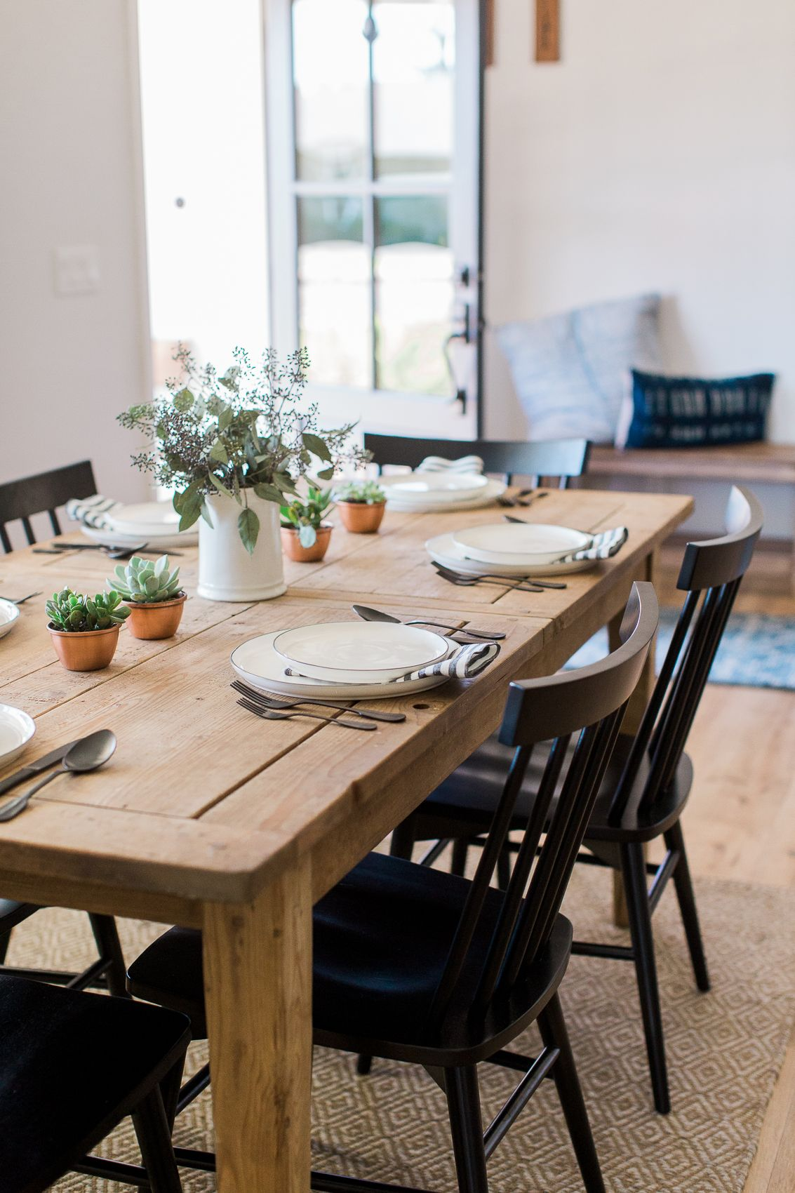 Dining Area With Natural Farmhouse Table And Black Windsor Style Dining Chairs Natural Dining Room Farmhouse Dining Farmhouse Dining Room