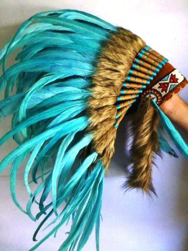 Amazing Turquoise Feather Headdress 42 scrollwork with turquoise yarn Handmade Native Feather Headdress, made with the best materials. colorful forehead band. large turquoise feathers. 42 pcs instead of the usual 32 rolls , scrollwork with turquoise yarn. width: 43,3 inch hight: 19,7 inch **This product will be ship with INTERNATIONAL EMS EXPRESS : 5-10 days** ( Also available to send express in 3-4 days worldwide with extra fee, ask for it) Elegant model. In Stock, Ready to Send!!