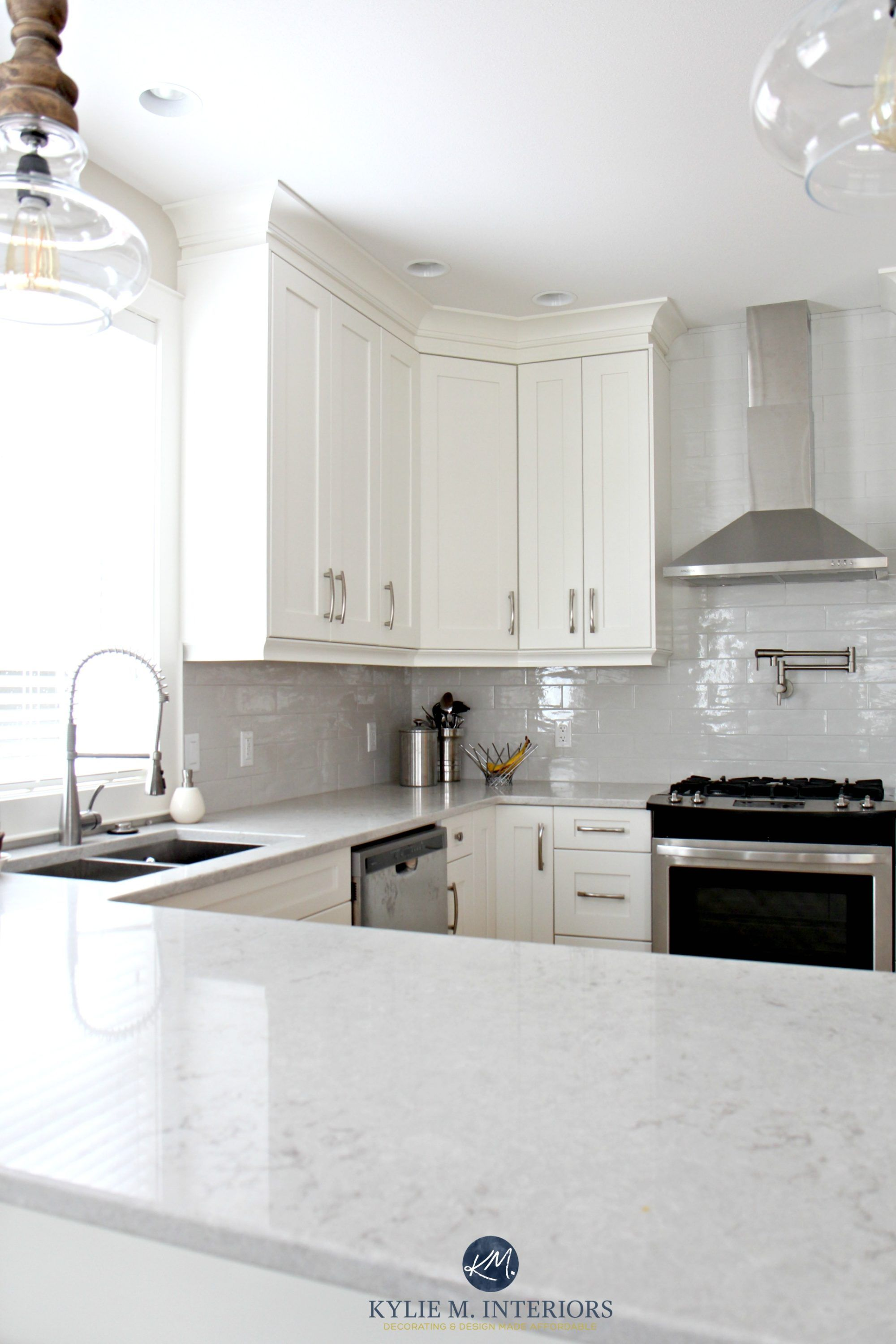 Low Contrast White Kitchen With Bianco Drift Quartz Countertops And Gray Subway White Shaker Kitchen Cabinets Kitchen Remodel Countertops White Shaker Kitchen