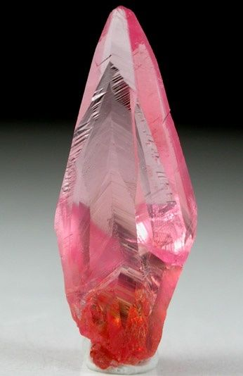 Elongated scalenohedral transparent red Rhodochrosite crystal from Hotazel Mine, South Africa