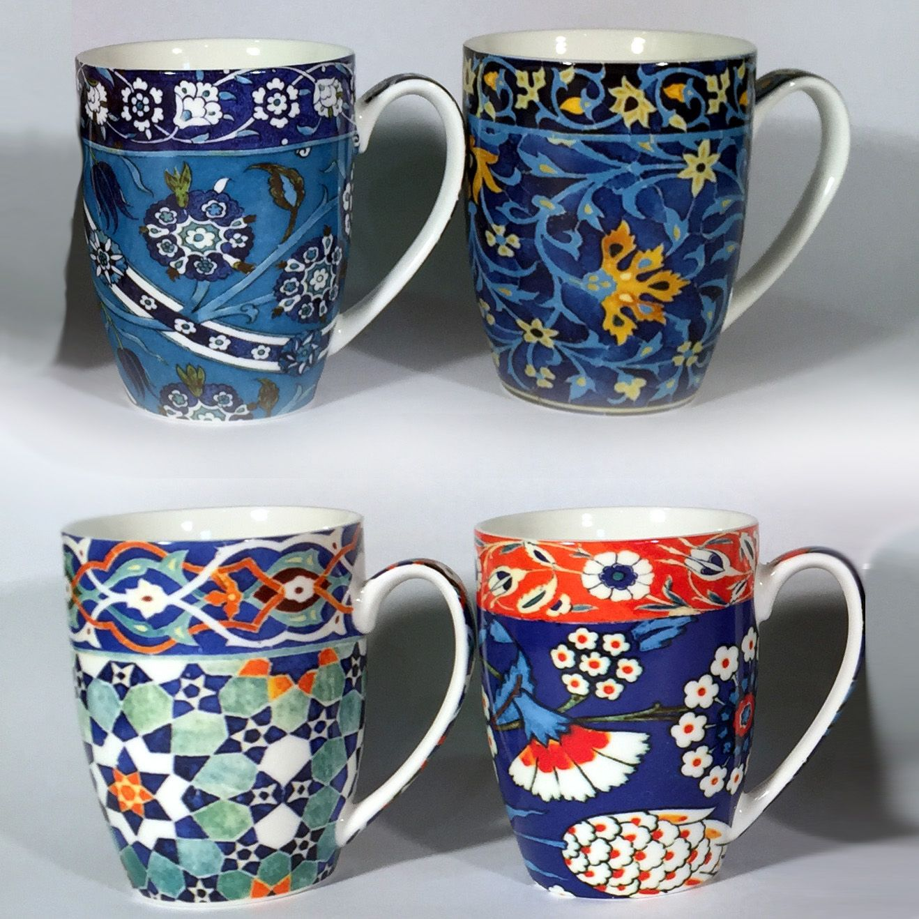 Four-piece boxed mug set. Matching placemats & coasters also available.