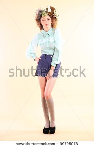 stock photo : Fashion model in spring light blue and purple clothes on beige background.