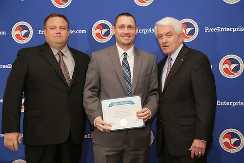 Midwest Computech CEOs Greg Miller and David Nivens accept the 2013 U.S. Chamber of Commerce Blue Ribbon Small Business of the Year Award from the US Chamber of Commerce President Tom Donohue