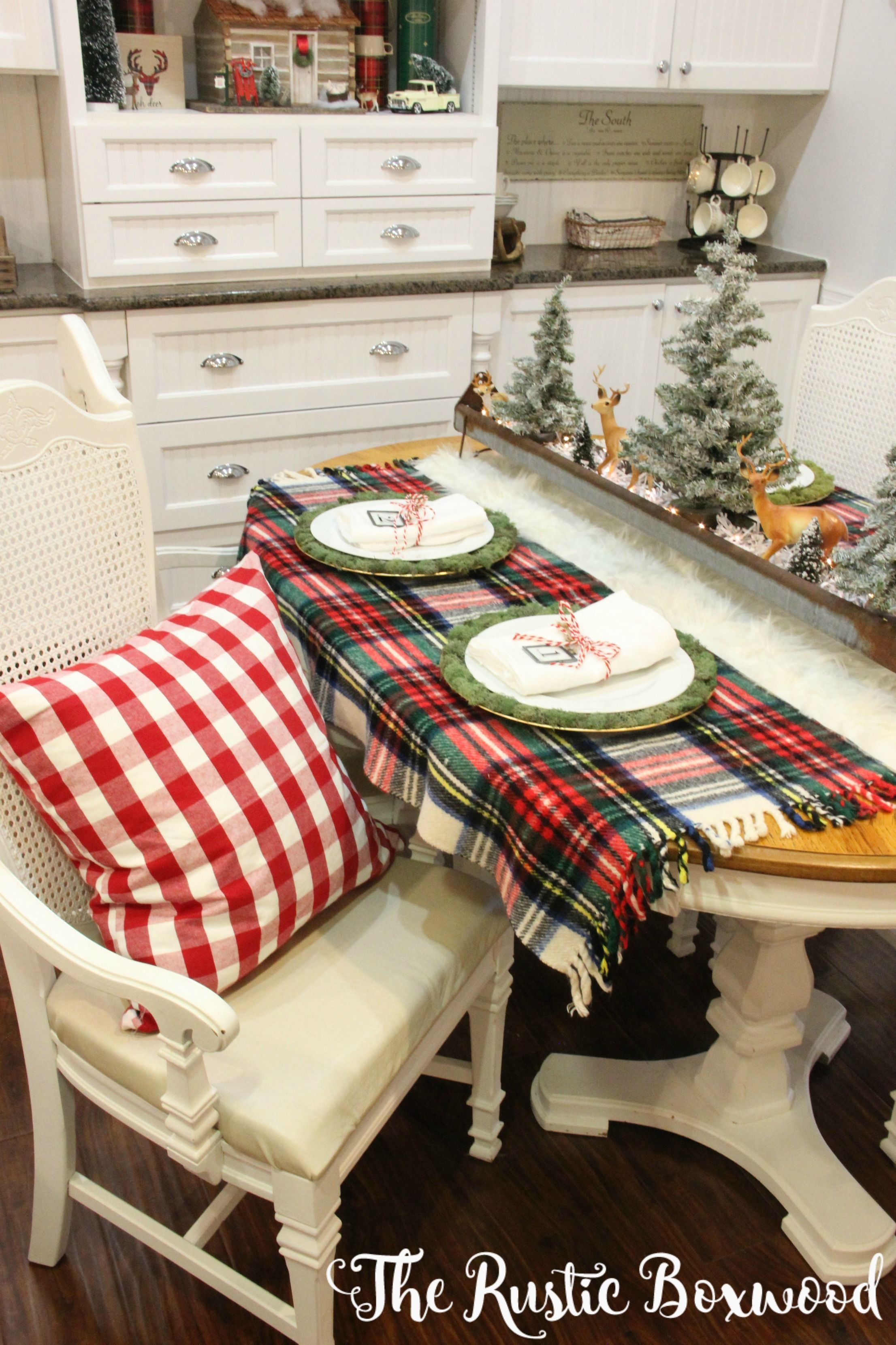 Christmas tablescape   The Rustic Boxwood   diy, farmhouse style, chicken feeder, string lights, christmas decor, christmas decorating ideas, christmas dining room, vintage, plaid, rustic, woodlands theme, woodsy decor, lodge style, woodlands christmas decor