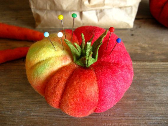 Order includes 1 Felt Tomato You will receive the Tomato shown in the last photo.  Description: Original Design Eco-friendly Poly felt Stitched Fabric adhesive Batting Approx. 3Dia. x 2 1/4H  Add a little whimsy to all your sewing projects with this neat alternative to the old fashion tomato pin cushion :) It also makes a fun gift for your friend or child. But dont forget to treat yourself. It is sure to bring a smile simply adorned on your desk.