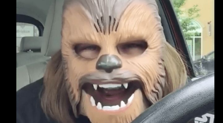 Woman Trying On Chewbacca Mask Is The Happiest Thing You'll See All Day