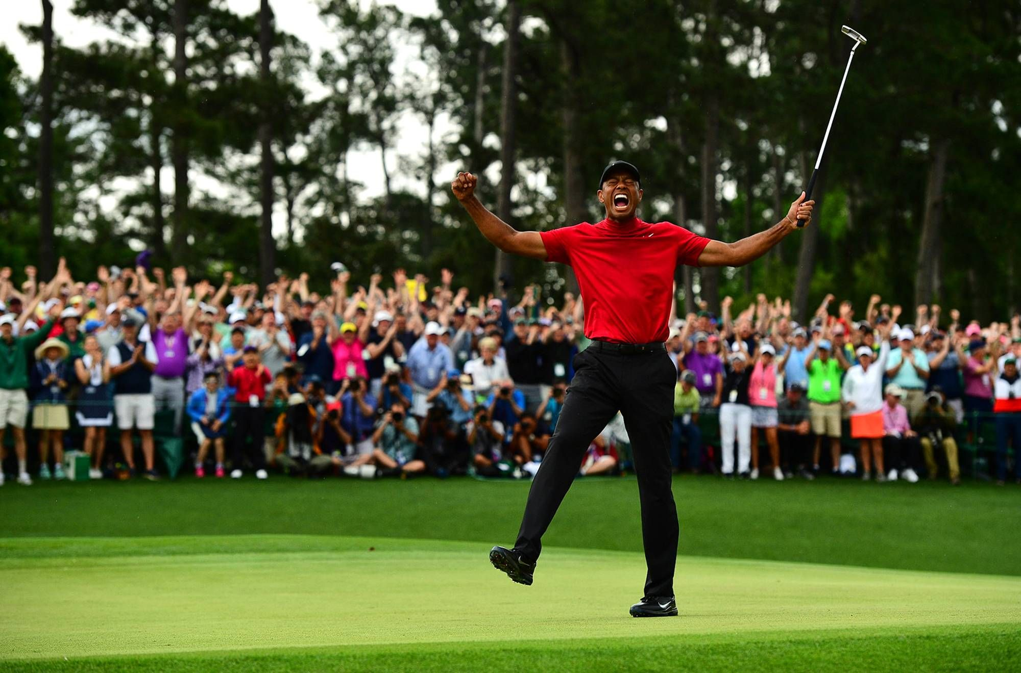 Tiger roars again In red, in green, and at Augusta