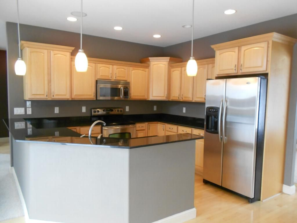 black granite countertops with maple cabinets - Google ... on What Color Granite Goes With Honey Maple Cabinets  id=78391