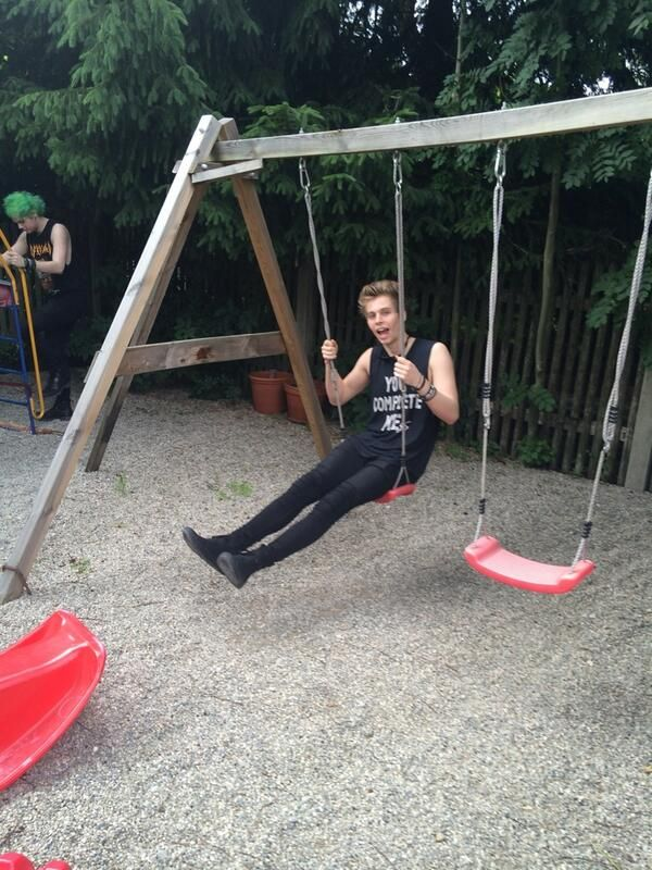 Luke. No. Can you not. lol I'm surprised he didn't break the swing! :p he's just too cute!