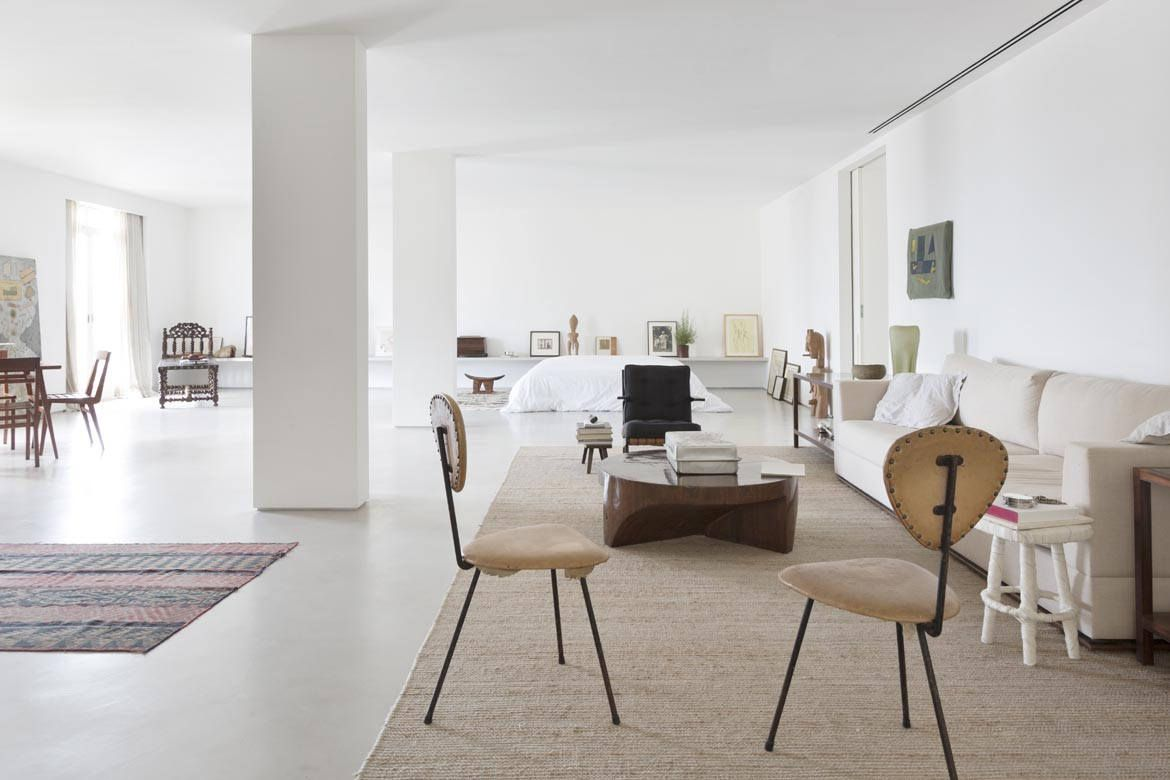 The single bedroom measures 1100 square feet to break up the space the designers created discrete seating areas