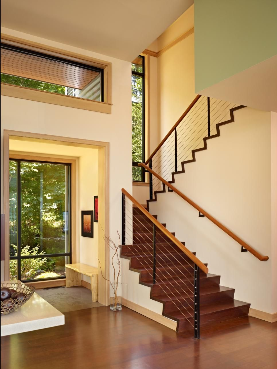 This+light+and+bright+foyer+boasts+cream+colored+walls+paired+with+a ...