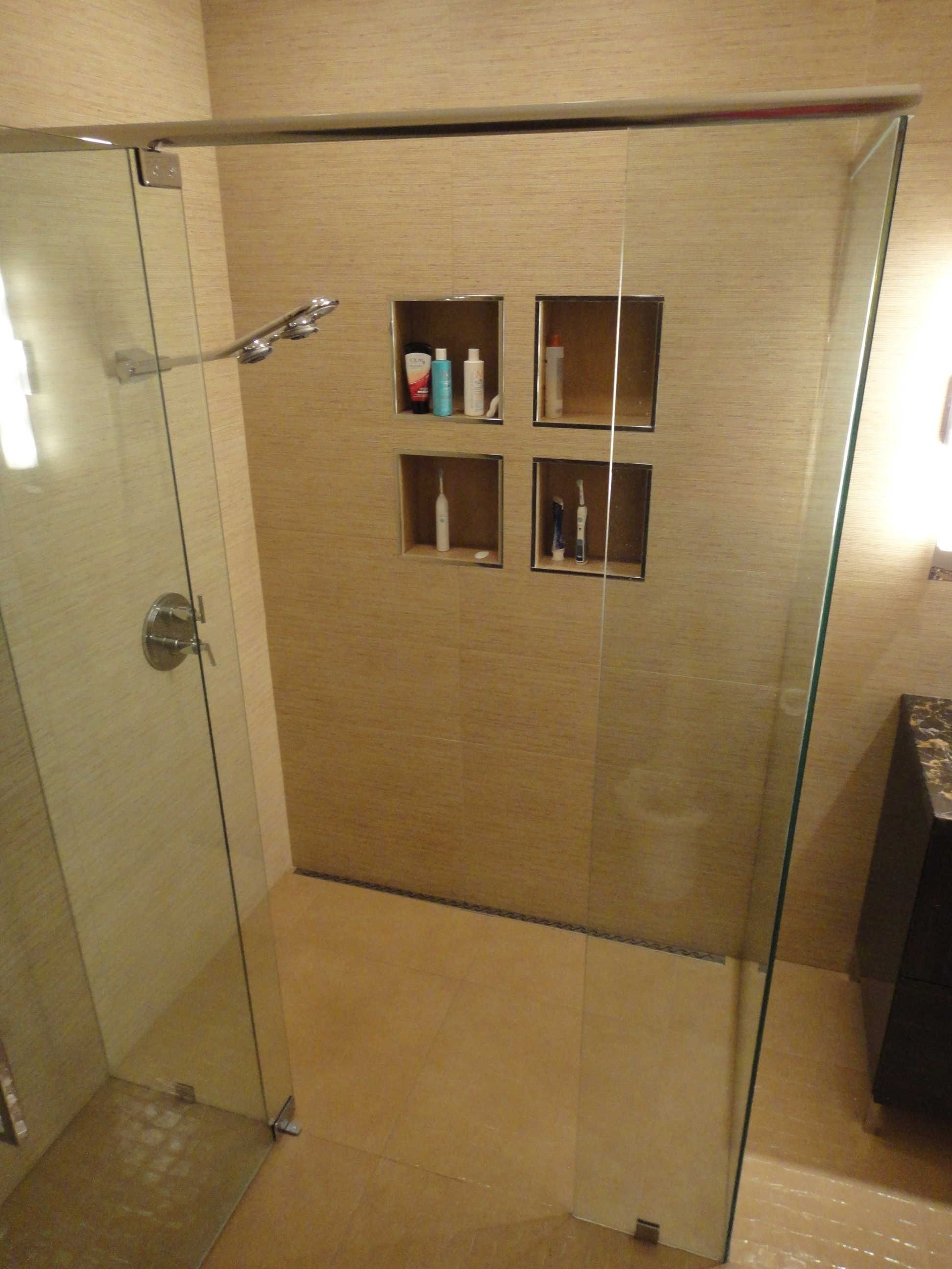A rear shower pan drain is sleek way to create custom shower kits ...