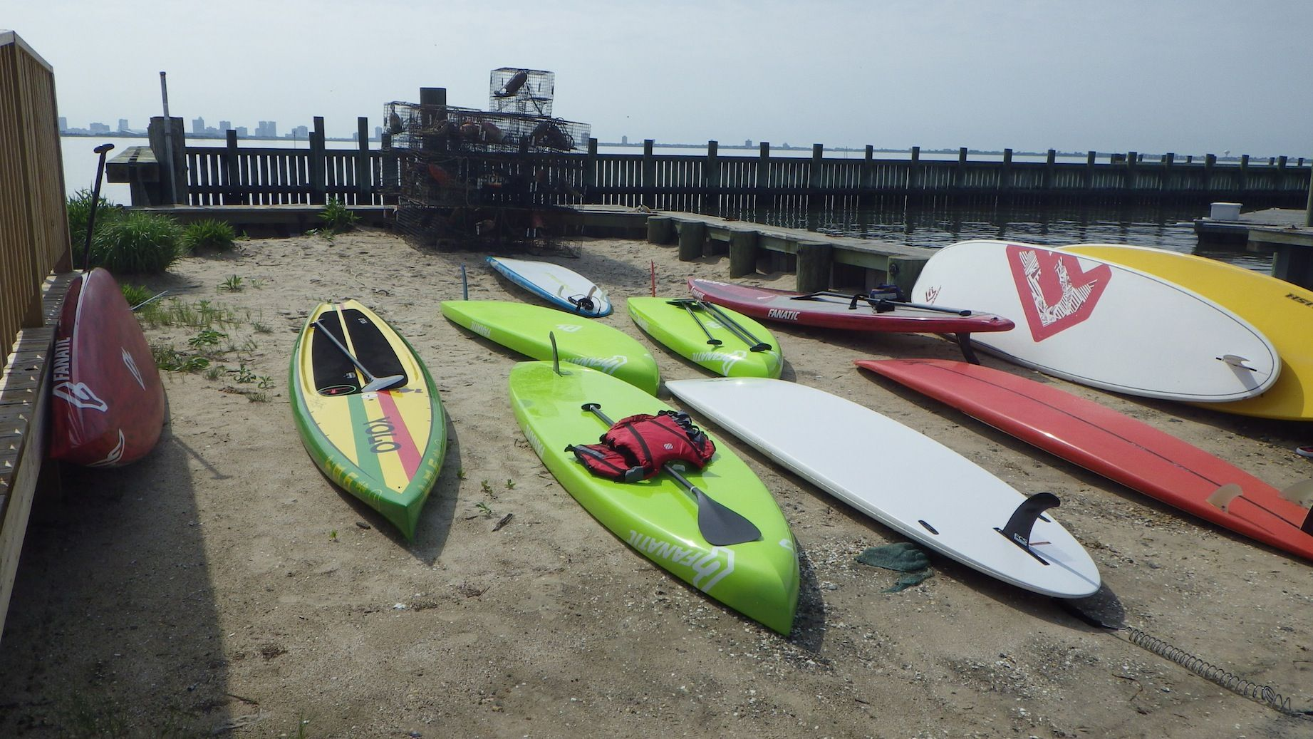 The boards of a bunch of the Donny Fund paddlers waiting for their riders to finish Breakfast at the Host Yacht Club of Pleasantville for the final leg of the Donny paddle back to the beach at Extreme Windsurfing in West Atlantic City