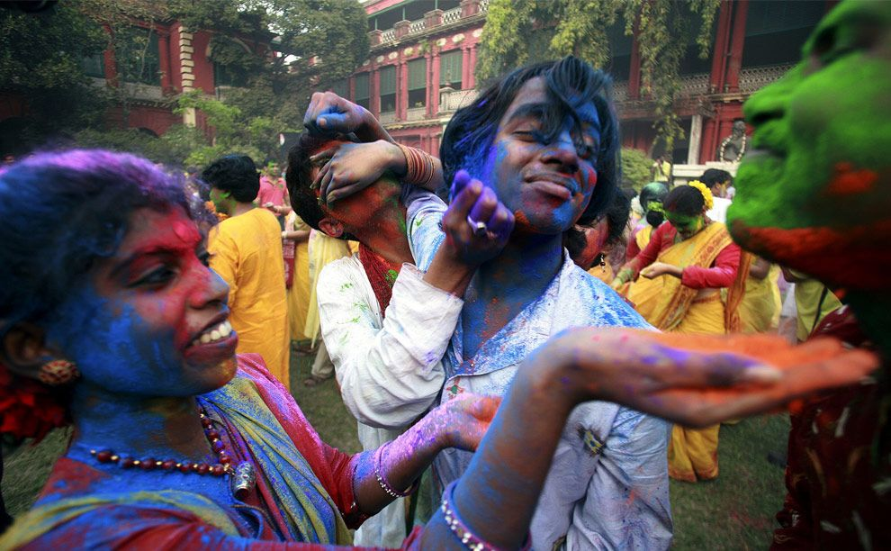 Last Wednesday (March 11th), people in India and other countries with large Hindu populations celebrated Holi, the Festival of Colors. Holi is celebrated as a welcoming of Spring, and a celebration of the triumph of good over evil. What that translates to in action is an enthusiastic dropping of inhibitions, as people chase each other and playfully splash colorful paint, powder and water on each other (REUTERS/Jayanta Shaw) #