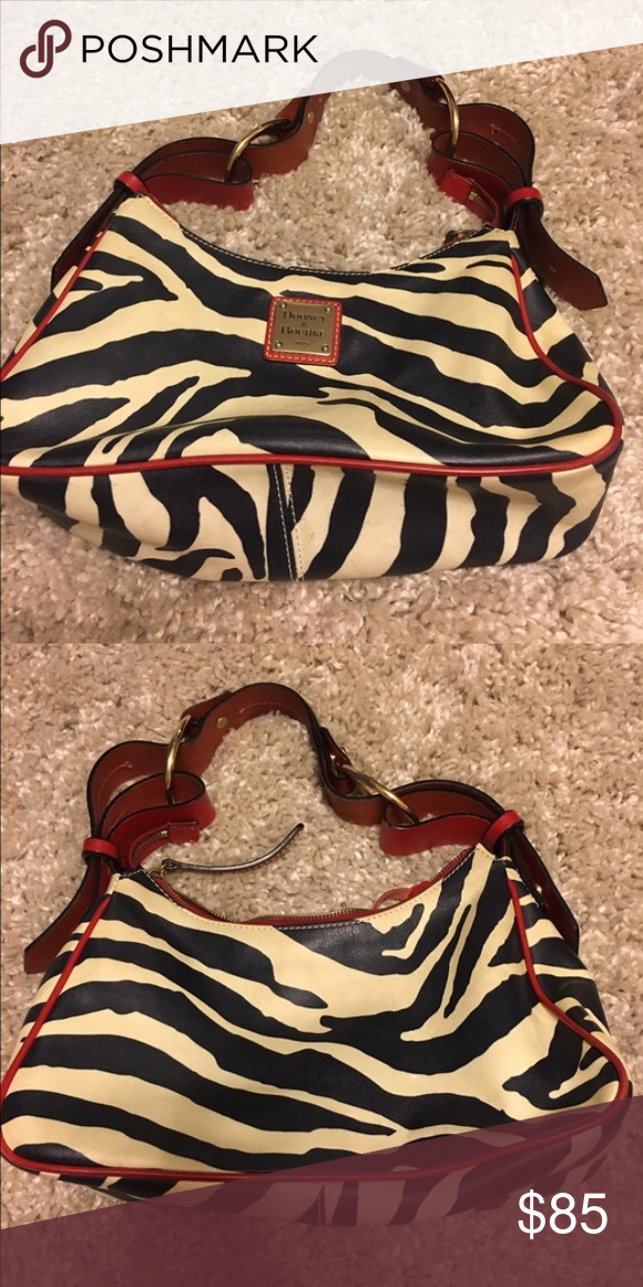 139b73ea22 Dooney   Bourke Handbag DB Handbag zebra print Handbag is in excellent  condition. No flaws