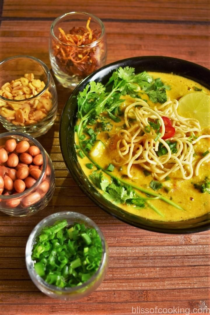 Khow Suey (Noodles in Coconut Curried Sauce) is a Burmese dish. This curried noodles dish is bursting with flavours. Khowsuey is a one pot meal with noodles, vegetables and coconut milk curry. The curry is well spiced with spices and garlic.