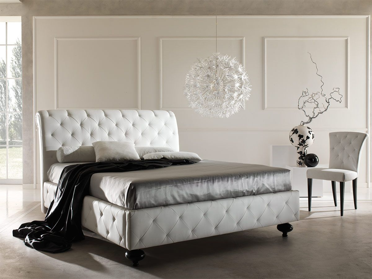 A Double Bed With Classic Lines And Finishing, Whose Padded Headboard,  Footboard And Sides