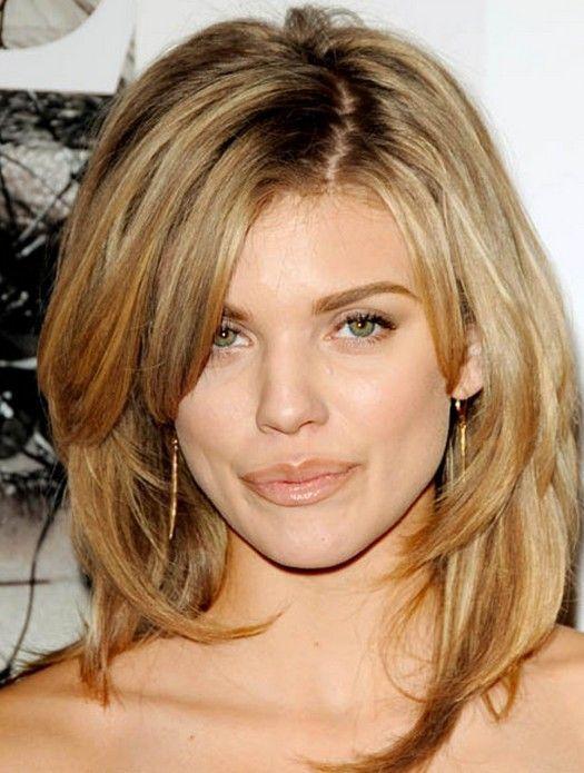 Soft wavy layers on medium length hairs Oval shaped face ...