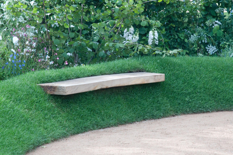 A Simple Piece Of Stone As A Garden Seat Garden