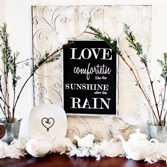 """DIY: Decorate a side table or shelf for Valentine's Day with an inspiring love quote in a frame. Using a die-cutting tool, cut a quote (like """"Love comforteth like the sunshine after the rain,"""" shown, or one of our other quotes, below) and glue the letters to black cardstock. Tape the finished piece to a mirror with an intricate frame to finish the Valentine's Day-ready decoration."""