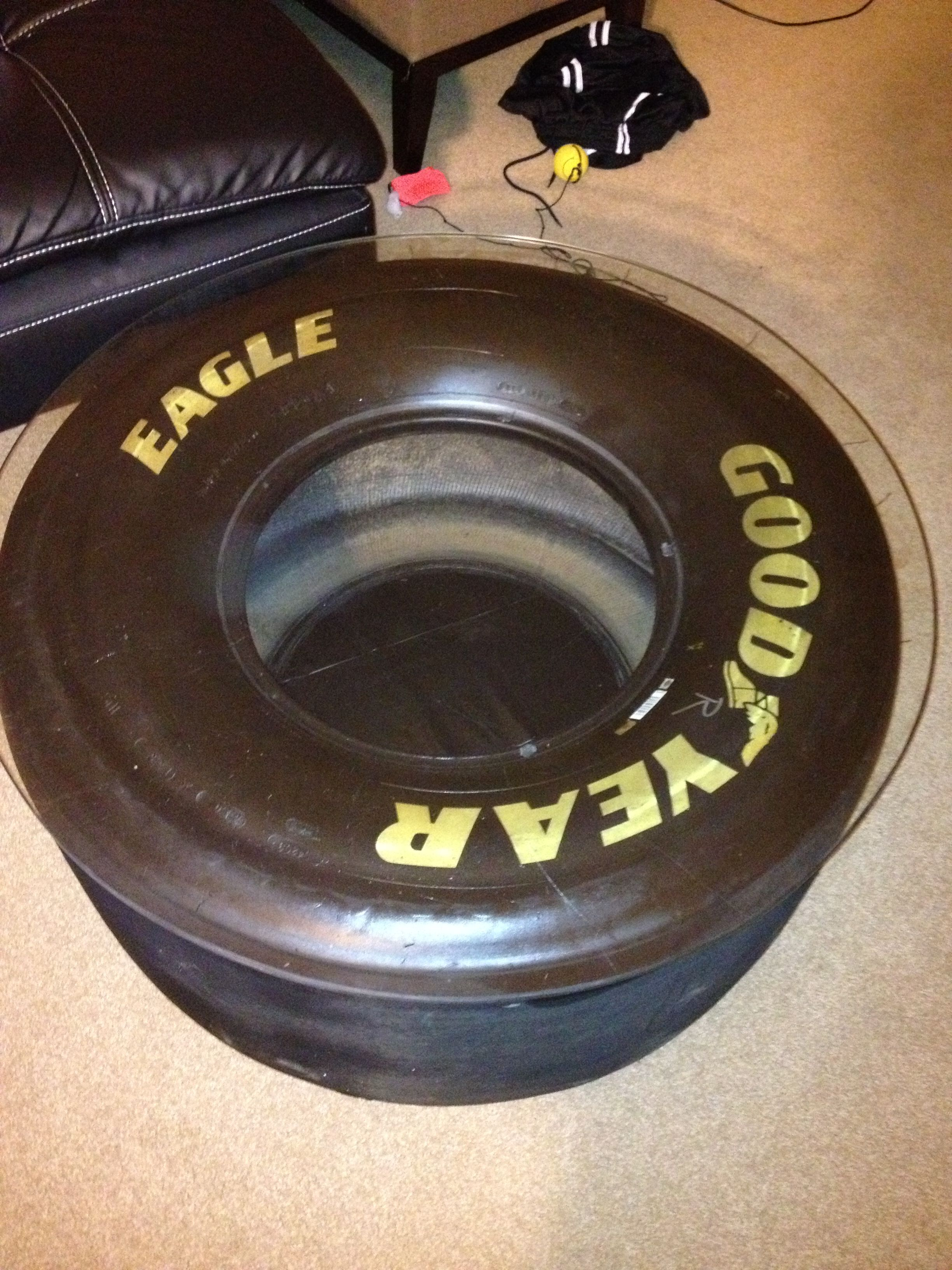 My son made this coffee table from a Nascar tire