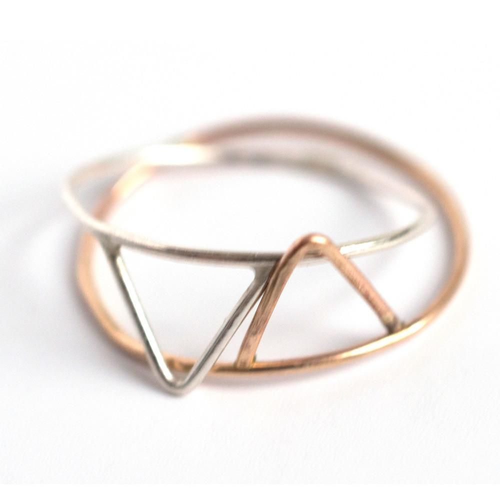 This cute triangle ring comes in sizes from teensy tiny for stacking to classic main finger sizes. www.mooreaseal.com