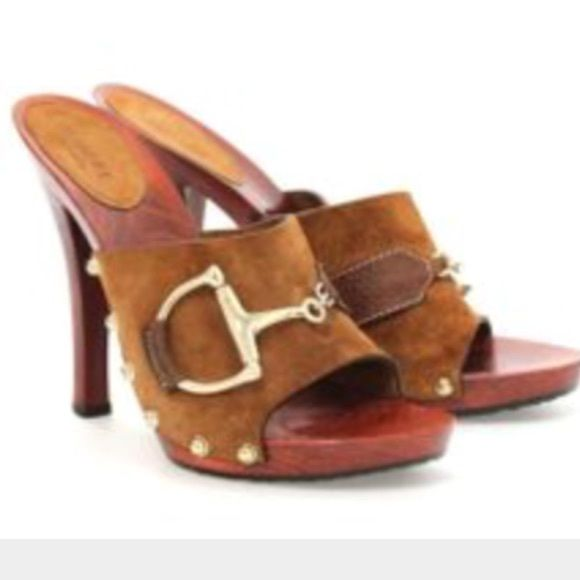 7c5a6db74a7 Gucci wooden mules Wooden mules with suede strap and classic gold Gucci  horse bit. These