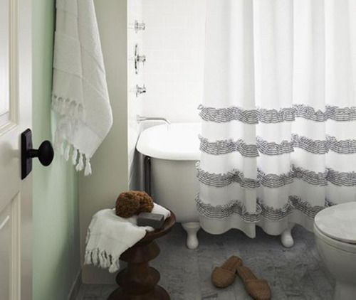 This DIY ruffle-filled shower curtain can also be converted to DIY ruffly floor-length embellished curtains if you so choose! (via apartment therapy)