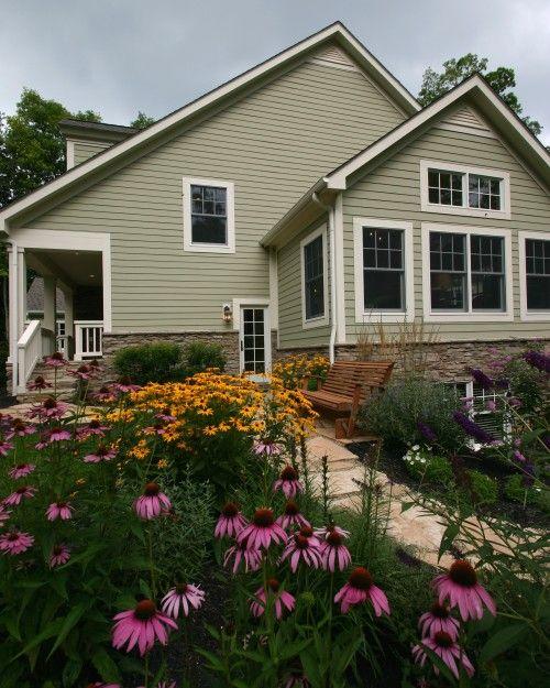 Color Scheme Light Green Siding With Tan Stone Veneer And Native Perennial Garden Exterior
