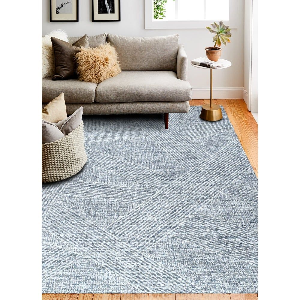 Enter a world where the rug is the focul point of your dcor where pattern and texture mingle in harmony. Hand-tuffted by skilled artisants, these all loop wool rugs are created in designs meant to be star attraction in your room. Sturdy, reinforced cotton canvas backing protects the carpet and adds an extra layer of cushion.