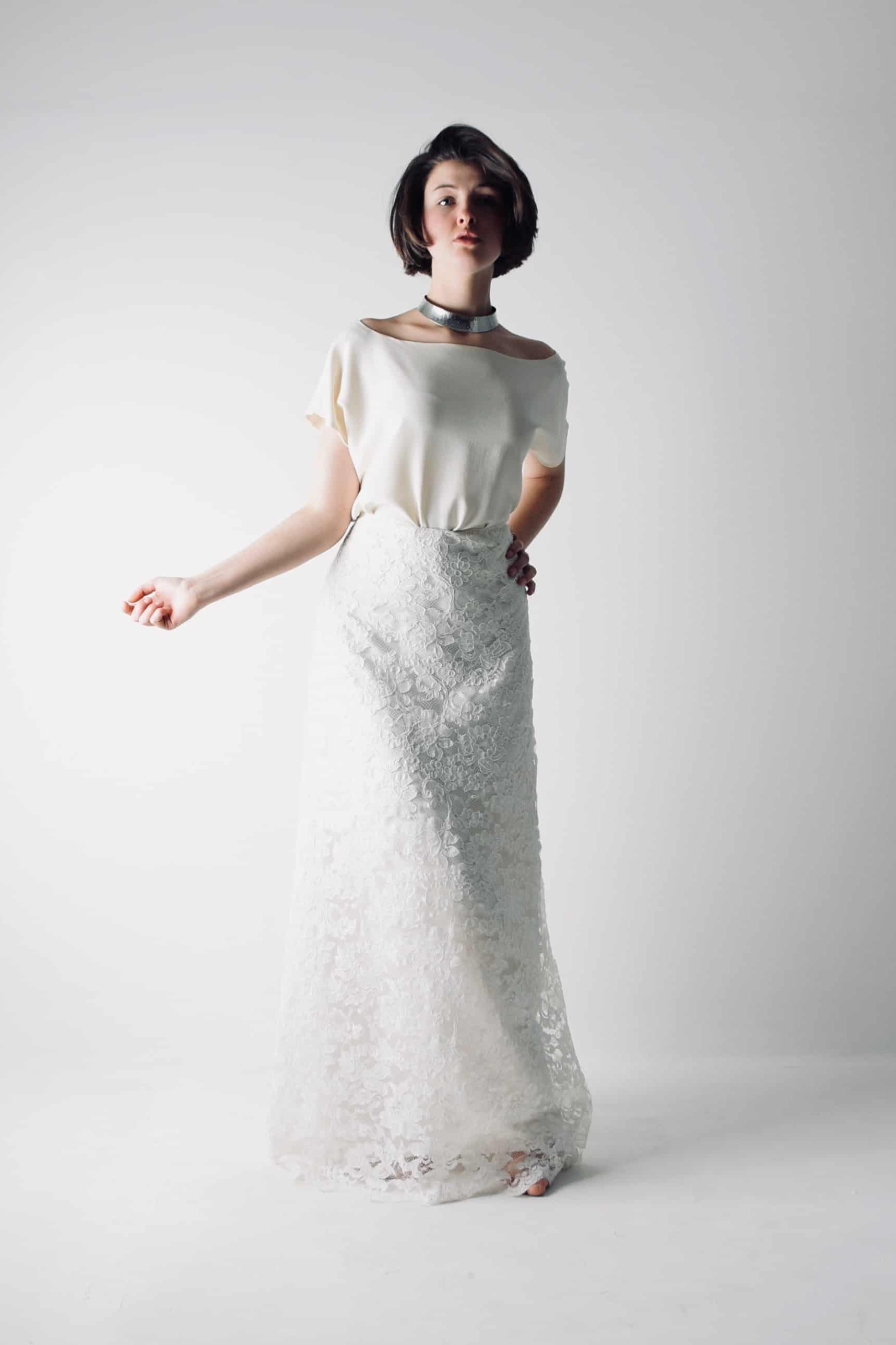 901d785d35ee Minimalist lace and silk two piece wedding dress. Wedding dress ideas, lace  skirt and short sleeve top in white. 2019 bridal trends.