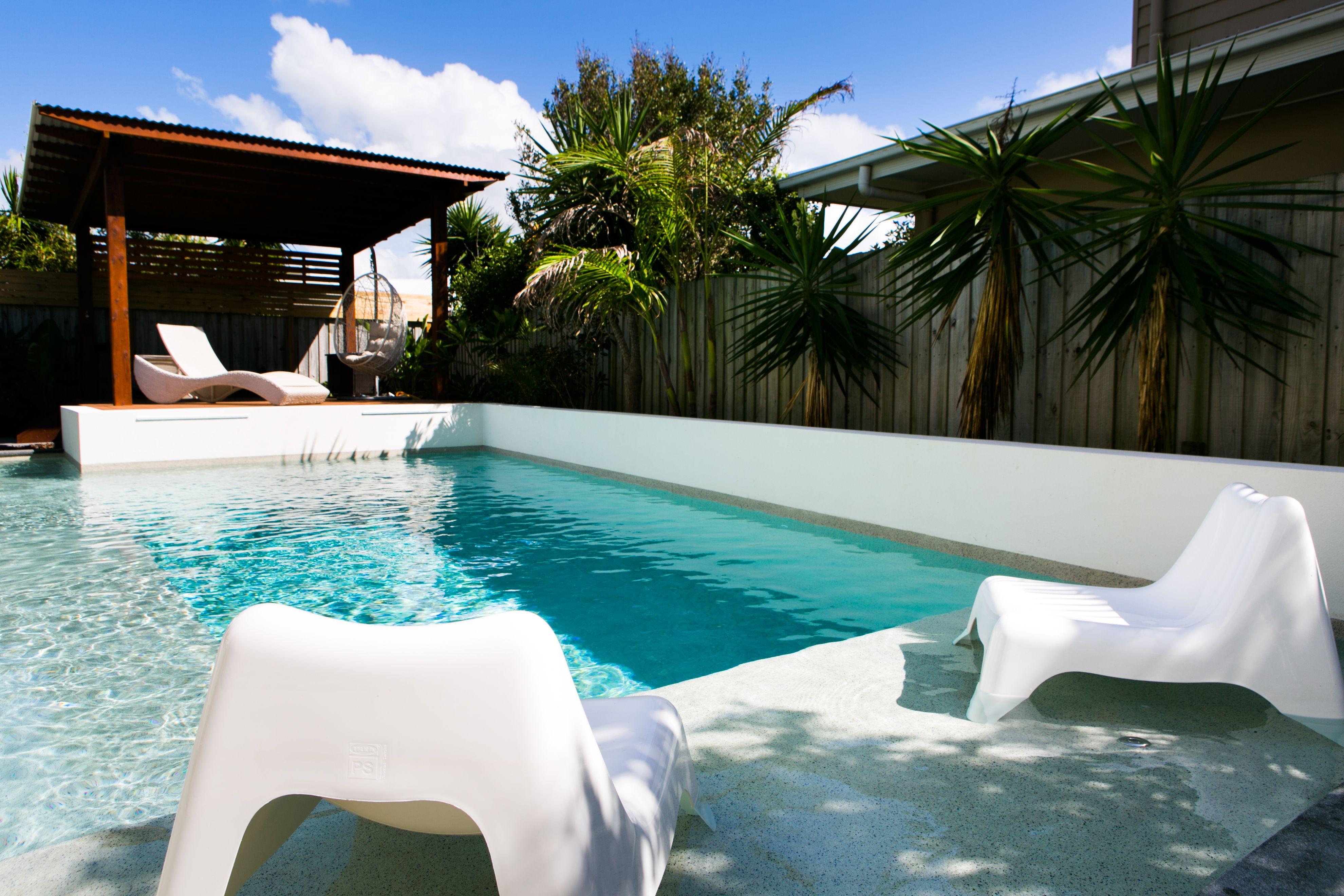 designer built concrete pool with shallow step area high rendered