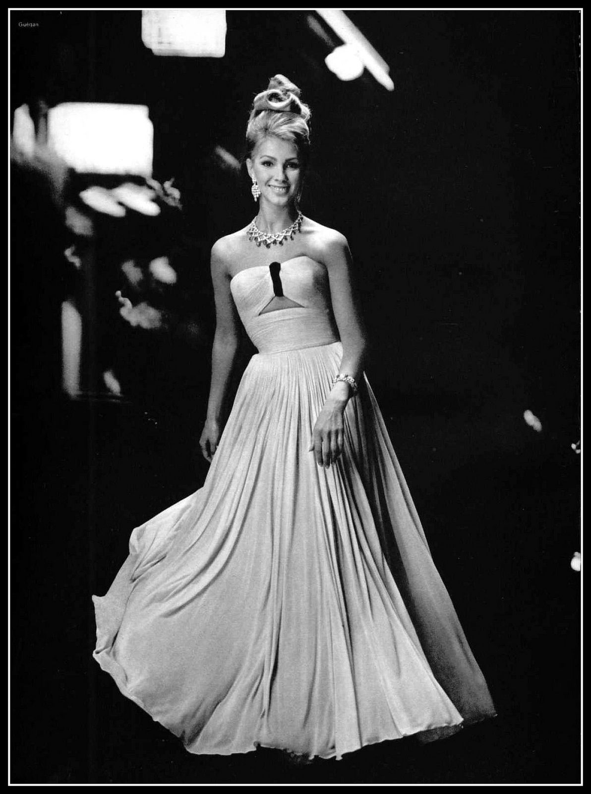 Model in pale pink jersey evening gown by Grès, coiffure