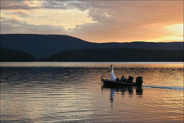 A Bride Motors Across The Placid Waters Of Lake Dardanelle