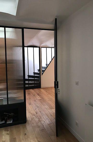 Réaménagement dun espace atypique grand loft sous verrière en souplex espace