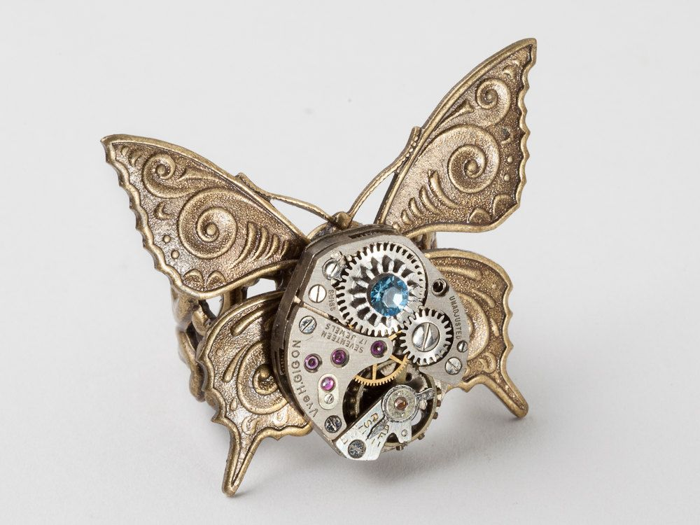 Industrial Steampunk Ring vintage silver watch movement gears blue crystal gold butterfly filigree Steampunk jewelry Steampunk Nation 1895. $49.00, via Etsy.