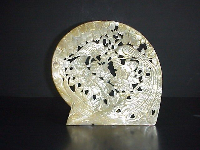 carved mother of pearl peacocks in trees