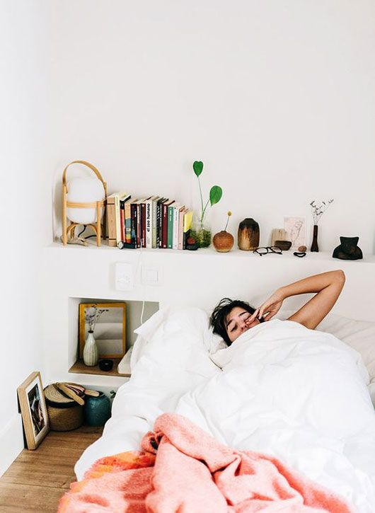 woman waking up in white bed with pink blanket via @salvalópez. / sfgirlbybay