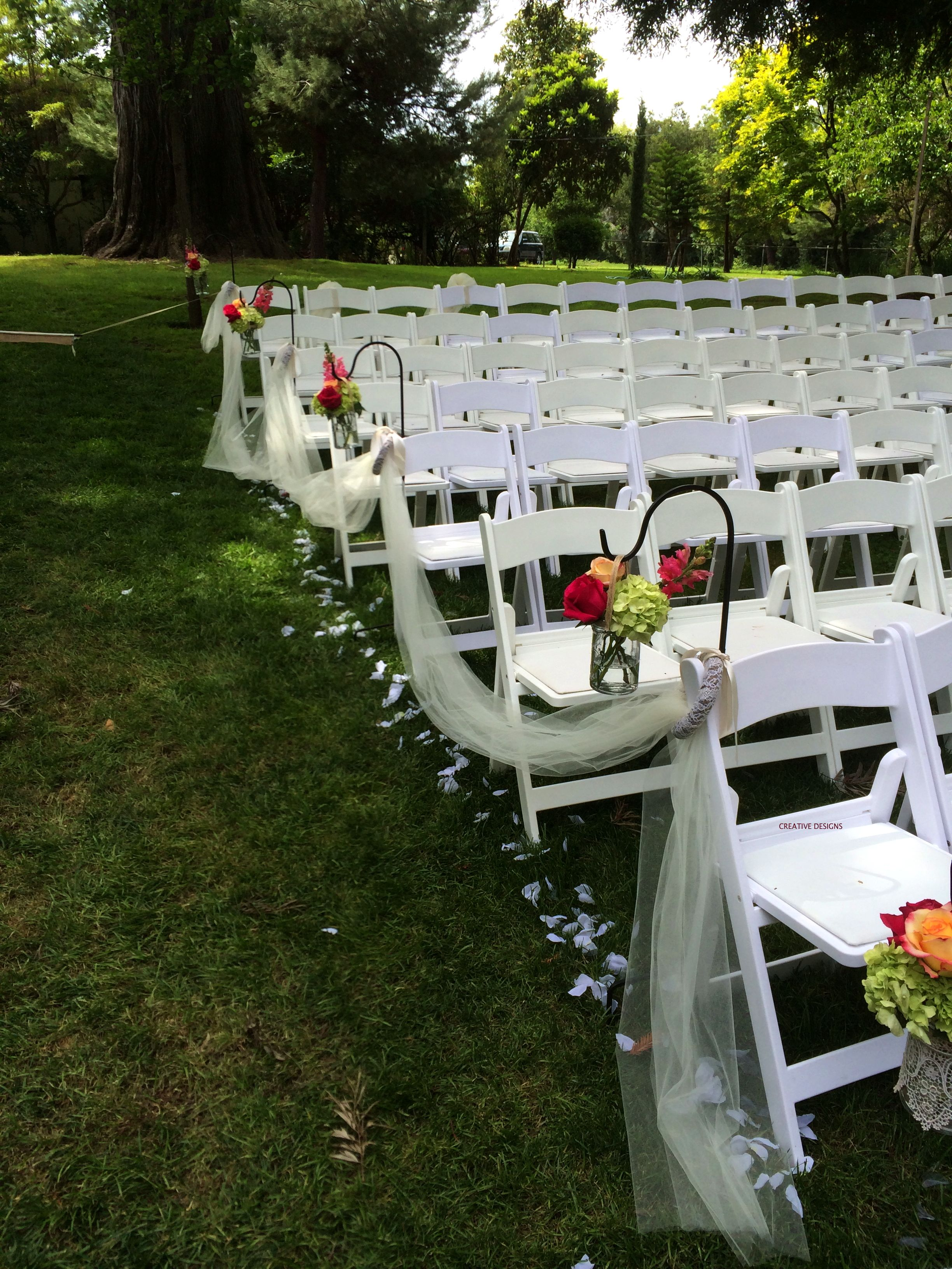 Aisle Decoration Of Shepard Hooks To Hold Flower Filled Mason Jars